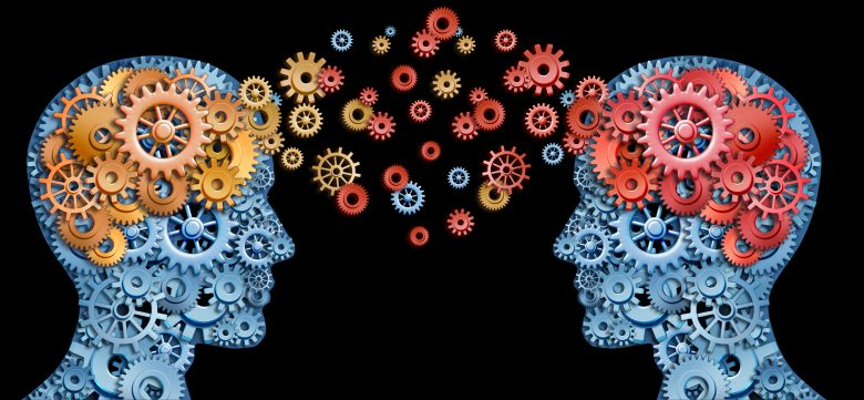 Two human heads shaped with gears with red and gold brain idea made of cogs